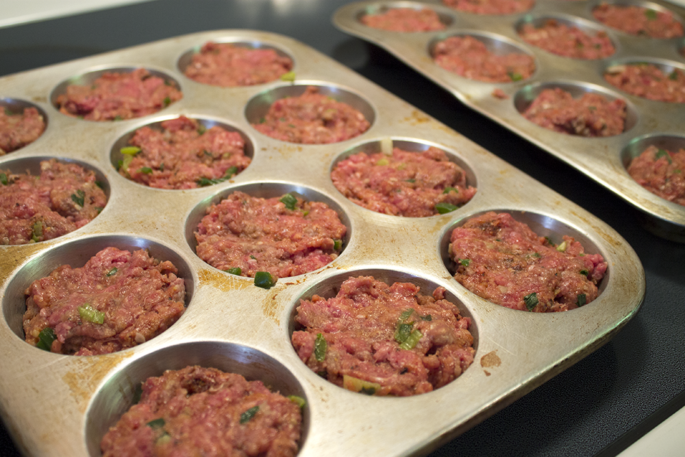 Place Chipotle Meatloaf In Muffin Tins